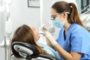 Dental hygienist cleaning a patient's teeth